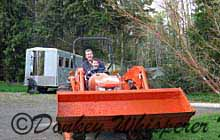 Scott giving Xander a ride on his tractor