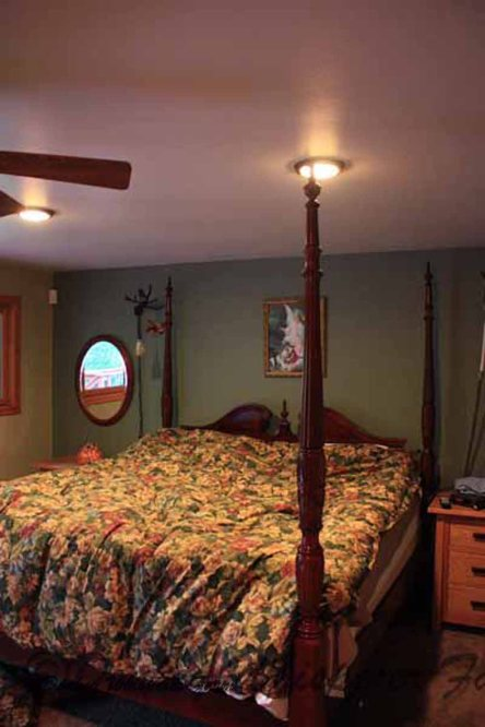master bedroom with slider out to theraputic hot tub with a bed in it