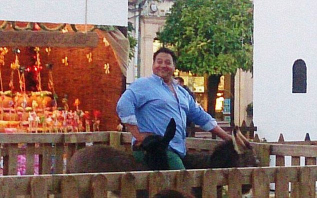 Photograph distributed by Podemos Animalista of the man on the donkey Animal lovers in Spain have reacted with fury after a young donkey, held in a pen as part of a Nativity scene, died after being sat on. The donkey, named Platero, was being held in the town of Lucena, in the Cordoba province, as part of their annual Christmas celebrations. He was being held with other animals in the Nativity - and were not supposed to be touched by the public. But on December 10 a man climbed over the fence and, in a photo widely shared on social media, sat on the small animal's back. Two days later the donkey was unable to stand, and was taken to the vet's where had to be put down.